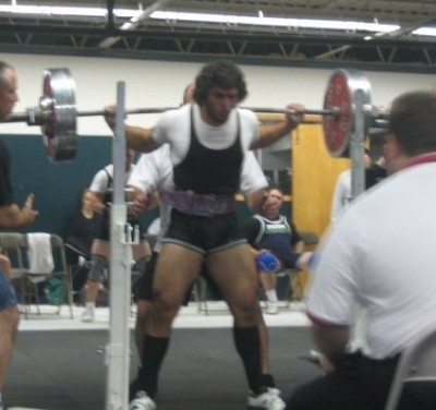 AC squatting in competition last November